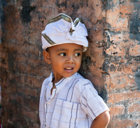 BALI, INDONESIA - AUGUST 22,2012:boy in holiday attire on a Balinese ceremony