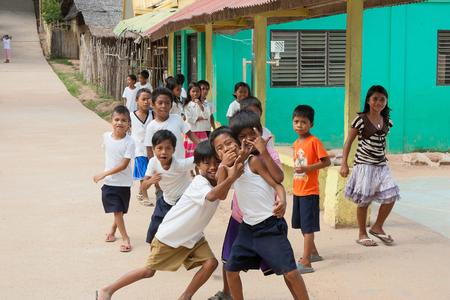 POPOTOTAN ISLAND, BUSUANGA, PHILIPPINES - JANUARY 20,2012 - Children playing on a school break in the Philippine village Redakční