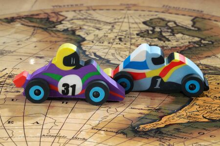 geographic: Toy cars drive on a geographic map
