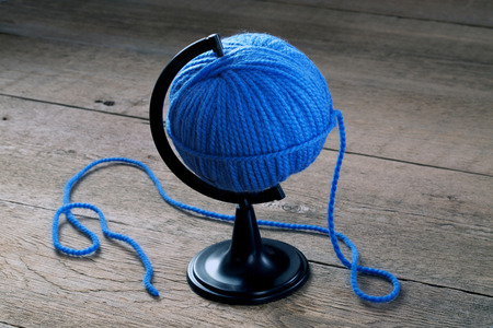 blue ball of yarn on a stand for the Globe Reklamní fotografie