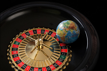 The globe lying on the roulette wheel
