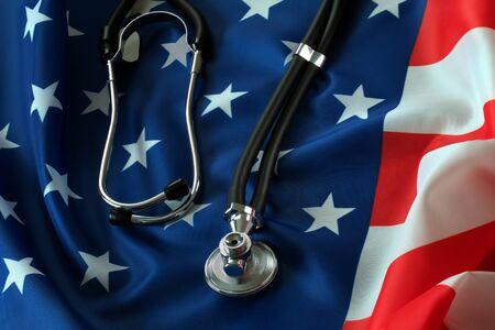 carefully: Stethoscope lying on the American flag