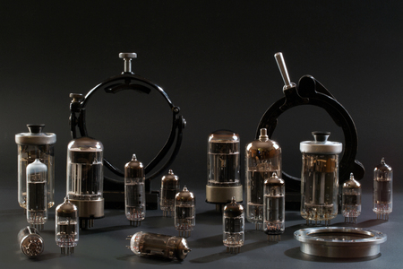 Radio tubes and laboratory equipment on a black background Stock Photo