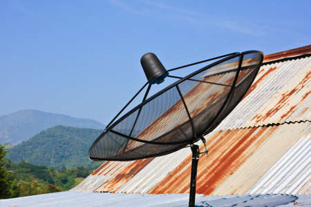 Satellite dish with sky on roof Stock Photo - 11665918
