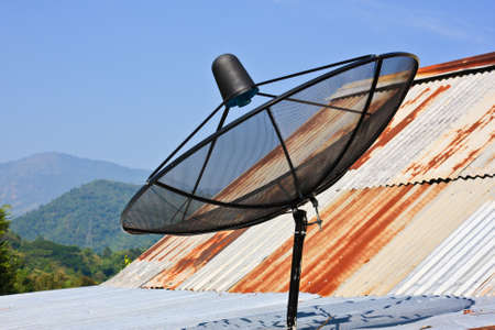 Satellite dish with sky on roof Stock Photo - 11665860