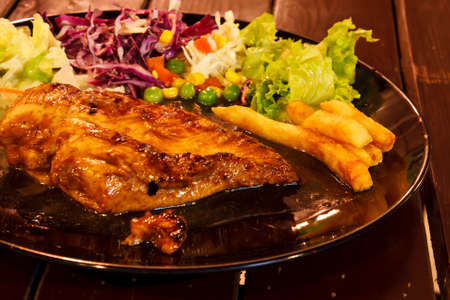 Grilled steak with salad photo