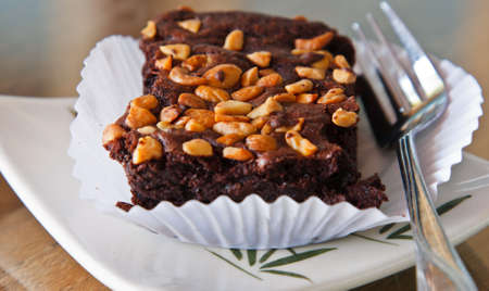 chocolate brownie cake with almond  photo