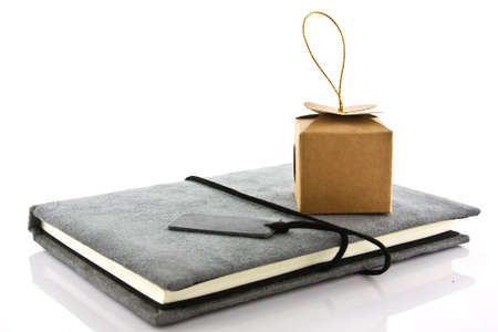 notebook and mini gift on white background