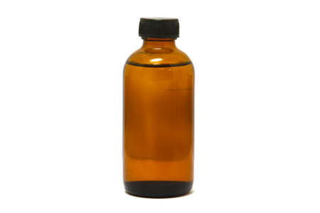Medicine bottle of brown glass isolated on white background photo
