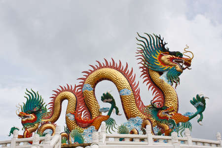 many color dragons on blue sky