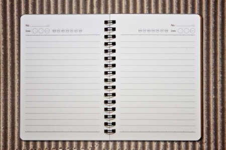 Notebook on the bamboo background photo
