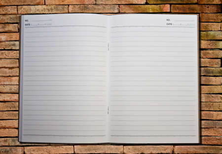 notebook on the brick background