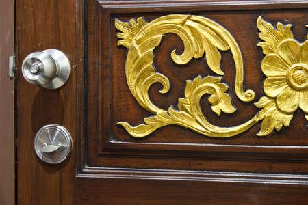 metal handle on a wooden door photo