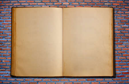 notebook on the brick background photo