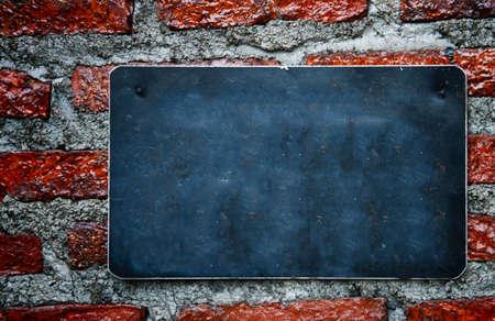 blank chalkboard hanging on brick wall   photo