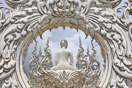Buddha isolated against the bright sky  photo