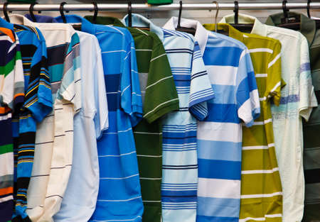 Colors of rainbow  Variety of casual shirts on wooden hangers Stock Photo - 17865483