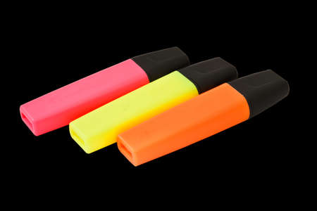 Colored highlighters on black background  photo