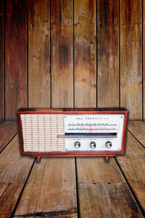 Old radio on wood background photo