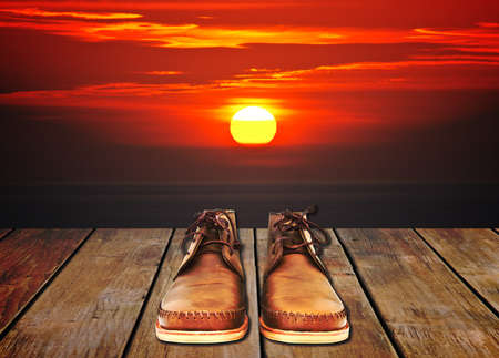 shoes with sunset background photo