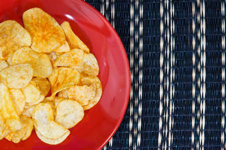 titbits: potato chips on wooden plate