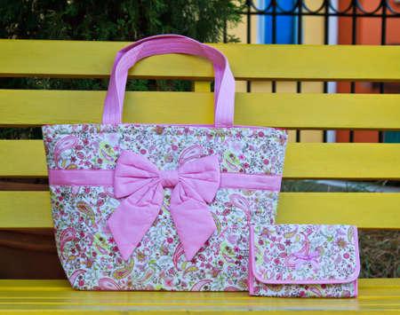 capacious: Luxury women bag on table in garden