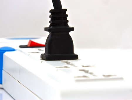 power outlet with red button on isolated photo