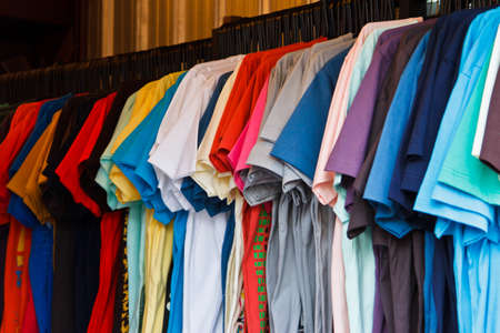 Colors of rainbow  Variety of casual shirts on hangers photo