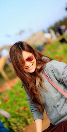 Cute woman in the flower field