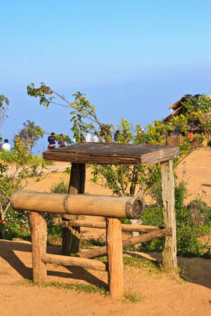 Empty wooden table with tea plantation