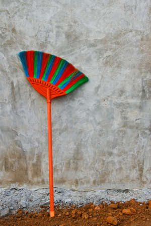 Red blue green plastic broom