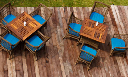 tables with chairs in the green garden photo
