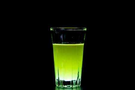 Delicious Smoothies of kiwi in glass isolated on a black background photo
