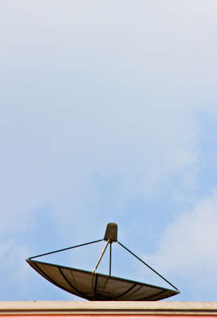 Satellite dish with blue sky photo