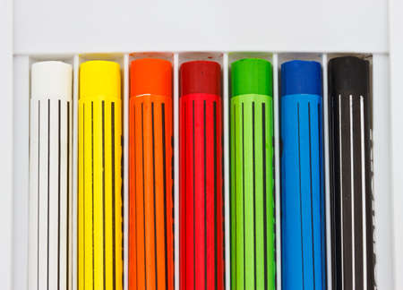 lined up: Crayons lined up in rainbow isolated on white background Stock Photo