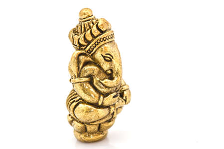 worshipping: Hindu God Ganesh Statue on white Stock Photo