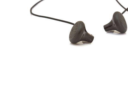 black earphones on a white isolated background photo