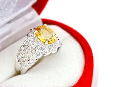 Yellow sapphire ring on white