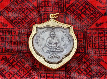 head stones: small buddha image used as amulets Stock Photo