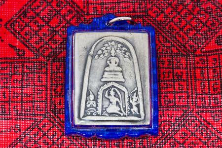 small buddha image used as amulets photo