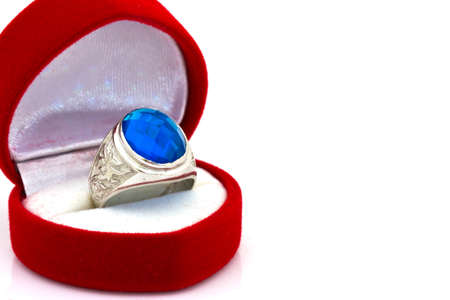 brilliants: ring of the jeweler with blue sapphire and brilliants on a white background