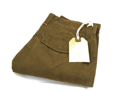 khaki pants: New trouser and tag isolated on white