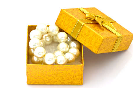 gold gift box: pearl necklace in a gold gift box Stock Photo