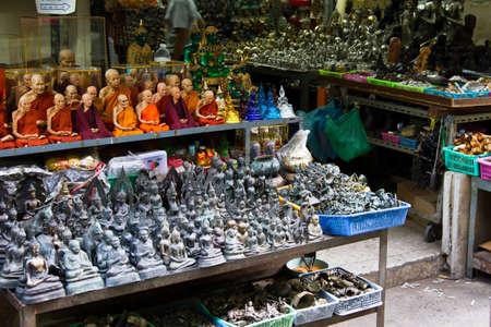 Plenty of religious souvenirs at Asian market photo