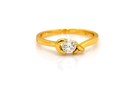 Wedding gold diamond ring isolated on white photo