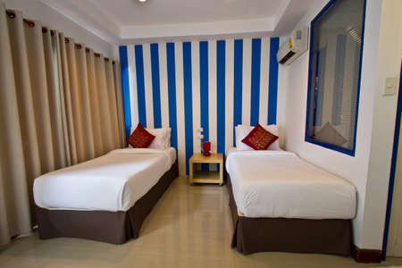 bedstead: interior of hotel room - two bed room