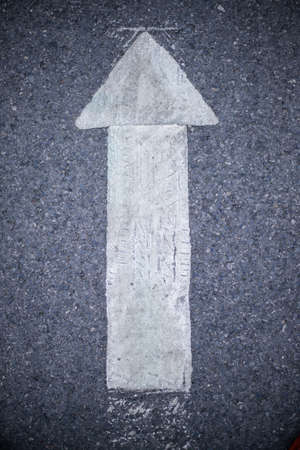 markings: Arrow signs at road markings on a street Stock Photo