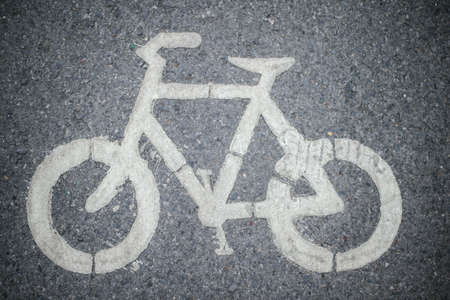 Bike symbol on the bike lane road background Stock Photo