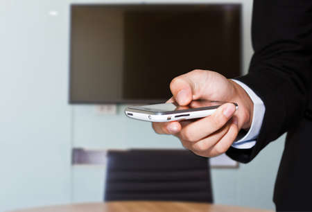 line lines luxury meeting: Close up of a man using mobile in office for business Stock Photo