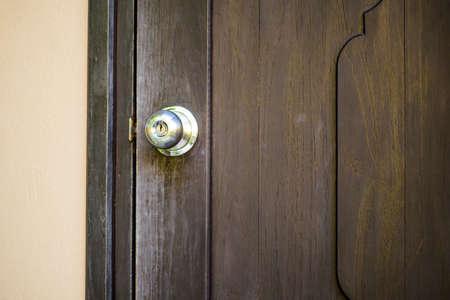 door knob: knob on old wooden door